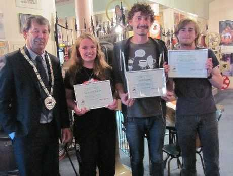 Mayor Neil Volzke with Savarna Pease, Josh Sheed and Shaymas Carroll who were recognised for their volunteer work in the local community at Stratford District Council's Youth Volunteers' movie night held last Monday.