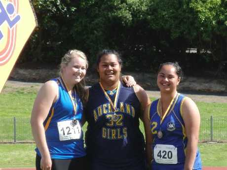 MEDAL WINNERS: Second-placed Katie Smith (left) with the other medallists in the senior girls' shot put at the national secondary schools track and field championships in Dunedin, winner Siositina Hakeai of Auckland Girls' Grammar (centre) and third-placed Kiriau Harii of James Cook High in South Auckland.