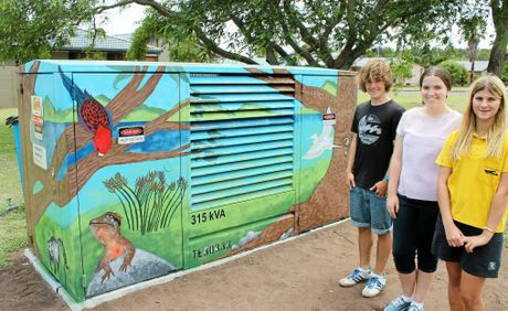 MAKEOVER: Southern Cross School K–12 students (from left) Jack Hawkins, Abby Miller and Cassie Kellett this week finished painting a mural on this Essential Energy transformer box in Chickiba Dr, East Ballina.