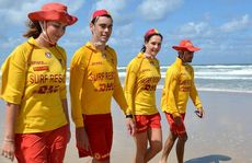 Lifesavers Tiffany Di Ianni, Sebastien De Paula, Kate Collingwood and Aaron Di Ianni patrol Marcoola Beach after it was closed due to rough conditions yesterday.