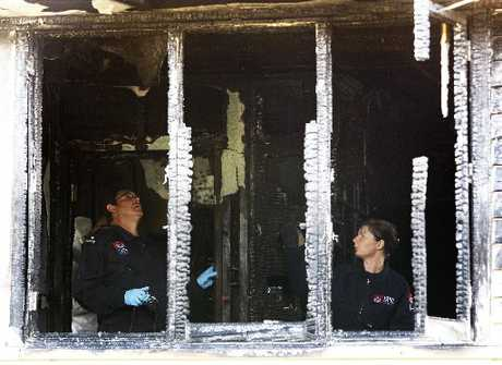 Fire investigators Craig Bain and Tracey Palmer at the William Jones Drive house. Photo / Michael Cunningham