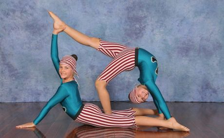 Fraser Coast Calisthenics Club - Tiana and Nicole Bird - sisters supporting each other in flex moves.