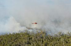 Bushfire on Noosa North Shore,Teewah. Becker Helicopters assisted with land crews in monitoring the fire.