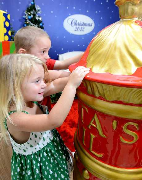 TO NORTH POLE: Kyhan and Zye Clark send letters to Santa at Ipswich City Square in the lead-up to Christmas.
