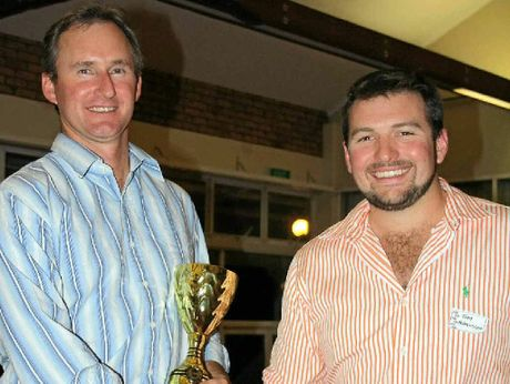 Achiever of the Year went to (left) Dwayne McLaren of Cecil Plains, who is congratulated by Pacific Seeds' Tom Ferguson.