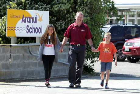 LEAVING RELUCTANTLY: Aranui School principal Shaun Priest with two of his Year 6 senior pupils, Shakiah Corby-Rata (left) and Jhavanni Allen. He has been principal for 24 years. PHOTO/STUART MUNRO