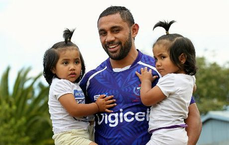 FAMILY FIRST: Tivaini Fomai with his twin daughters Kiera Alex (left) and Teiyah Heidin before another training session in the buildup to today's Central Region Sevens qualifier.