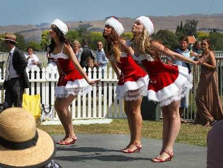 Off-track entertainment is proving a popular drawcard for Hawke's Bay Racing. Haleigh Pert (left), Breone Lay and Ashleigh Witkowski of Dance Express perform during yesterday's Twilight at the Races.