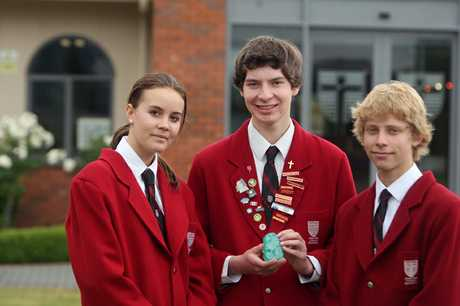 INGENUITY: John Paul College students Georgia Blatchford (left), 15, Fintan Walsh, 16, and Justin Bell, 15, placed well at a National BP Innovation competition recently.  061212BF1