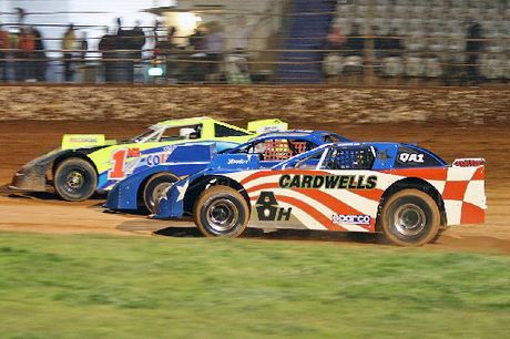 New Zealand super saloon champion Steve Flynn (in his yellow number one car) will be in Rotorua tomorrow as part of the Burger King Pro Dirt Series. Photo / Sportsweb Photography
