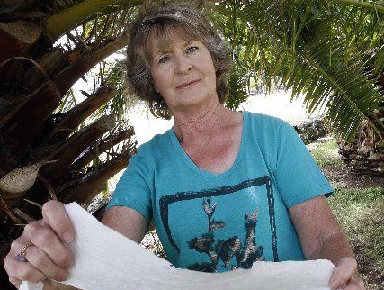 Caroline McLean who lives on Kensington Ave, among the palm trees people use for a toilet stop. Photo / John Stone
