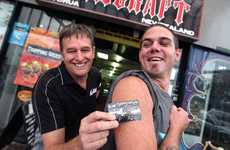 MAKING A DIFFERENCE: Nick Berryman (left) not only paid to advertise on Evan Hutchison's arm - he also gave him a job.