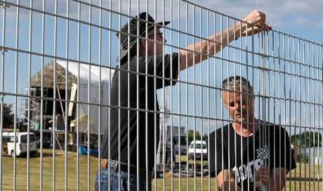 Des Parkinson and David Trim build a 1.5km temporary fence in preparation for Christmas in The Park, at Anderson Park, Greeenmeadows, today.