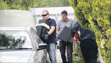 Police spent most of Friday removing evidence from a house they raided in Hastings which resulted in two arrests.