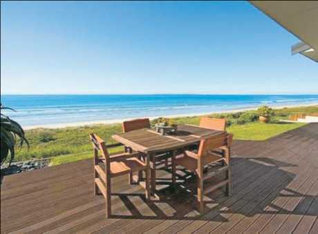 The property sits on a beachfront section between Marine Parade and the Omanu Surf Club and has spectacular panoramic views from both floors, which span the main Mount beach down to Maketu.