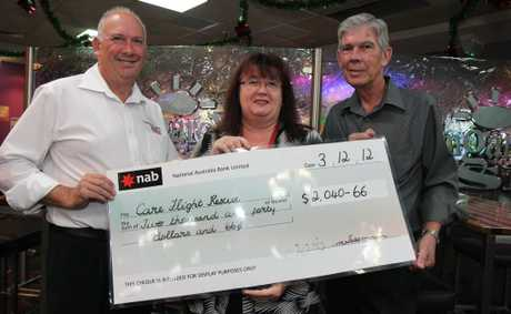 CHEQUE OF SUPPORT: CareFlight Wayne Evans (left) accepts a cheque from Kingaroy RSL's Maxine Tessmann and Jim King.