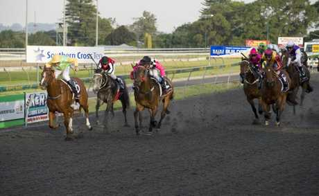 Tamamushi (left) holds on to give trainer Darryl Gollan and apprentice Travis Wolfgram a race-to-race winning double at Clifford Park on Saturday.