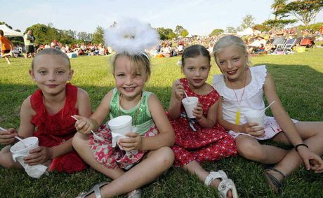 Lismore Carols Riverside park 16-12-12. Having a great night at the Lismore Carol's 8yrs Isabella Cappe,and her sisters 4yrs Georgina, 6yrs Hannah, and 8yrs Edwina, all of Tregeagle. Photo Doug Eaton / The Northern Star