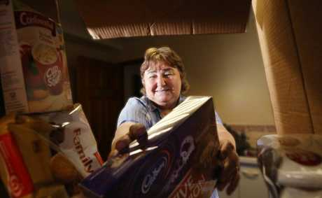 Colleen Benson from the Logan East Community Neighbourhood Association with hampers collected for the 2012 Adopt-A-Family. Photo: Inga Williams / The Reporter