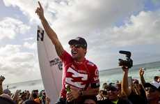 Joel Parkinson of Coolangatta, Australia (pictured) celebrates his Billabong Pipe Masters victory after winning the final over Josh Kerr (AUS) on Oahu, in Hawaii today. Parkinson won his maiden 2012 ASP World Title over Kelly Slater (USA) by advancing into the final while Slater was eliminated in the semifinals and went on to win the event.