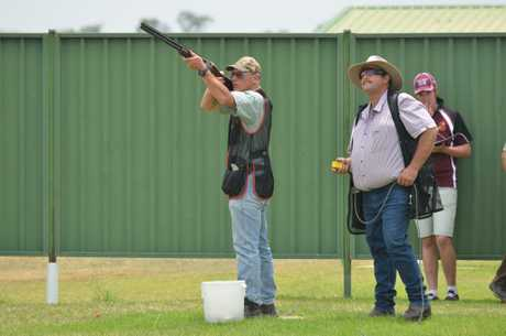 Local shooter Ian Johnston draws a bead on the skeet, with John Cormack throwing clays.
