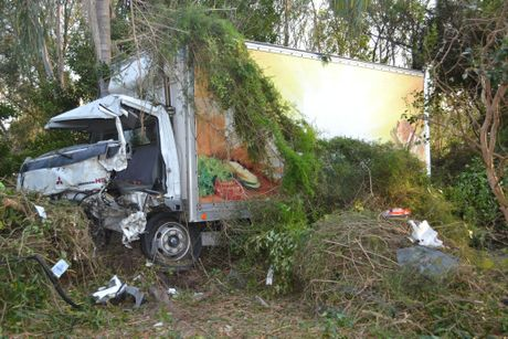 TRUCK CRASH: A small truck that was delivering furniture ran off the road into thick scrub just south of Woodburn this morning. Photo Samantha Elley / The Northern Star