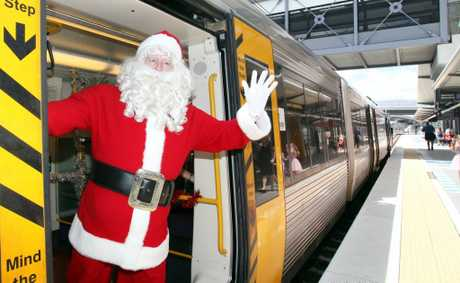 Santa arriving on the Santa Express at Richlands Station. Photo: Inga Williams / The Satellite