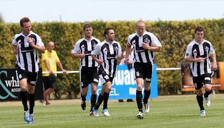 Dakota Lucas (No18) and fellow Hawke's Bay United players Cole Peverley (left), Stephen Hindmarch and Bill Robertson savour the first goal of the match on his debut in the 14th minute against Team Wellington, at Park Island, Napier, yesterday. Photo / Duncan Brown