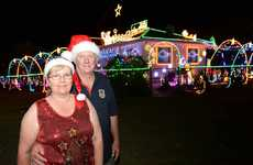 Suzanne and David Jamieson and their Barton Rd display of Christmas lights.