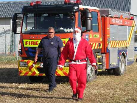 Hana Koko (Santa Claus), escorted by Kawakawa fire chief Wayne Martin, traded his sleigh for a fire truck.