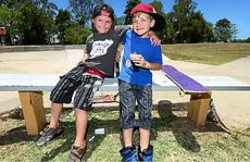 Mates Tristan Sticher, 6, and Oliver Salis, 6, both of Rosewood, take a break from their skateboarding.