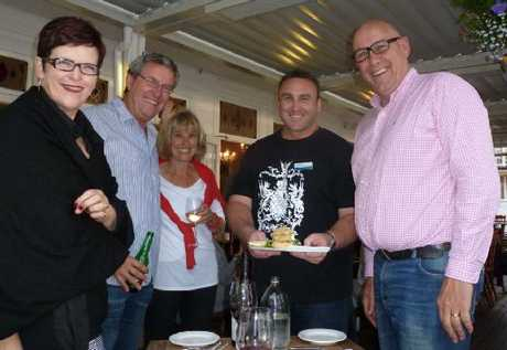 Mike Sabin serves an entree to Jenny Shipley and husband Burton, with former Team New Zealand boss Ross Blackman and wife Jo. Photo / Supplied