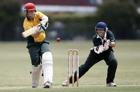 Onerahi batsman Todd Beehre looks to put one away to the rope as Kaipara wicketkeeper Rory Christopherson keeps a close eye.