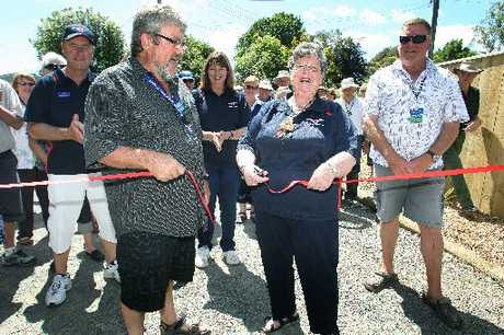 ROLL RIGHT UP: New Zealand Motor Caravan Association project manager Peter Willcox and board member Dawn Fellows cut the ribbon at the gate of the new park set up in Marton for their members.PHOTO/ BEVAN CONLEY