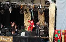 Santa is welcomed by Christmas at the Park comperes and Classic Hits radio show hosts Marin and Sarah. 