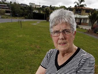 VERGE OF DESPAIR: Hilary Edmunds on the large berm outside her house.