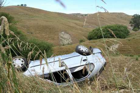 ESCAPED: This stolen car was found abandoned and upside down, after a crash near Waimarama on Saturday.
