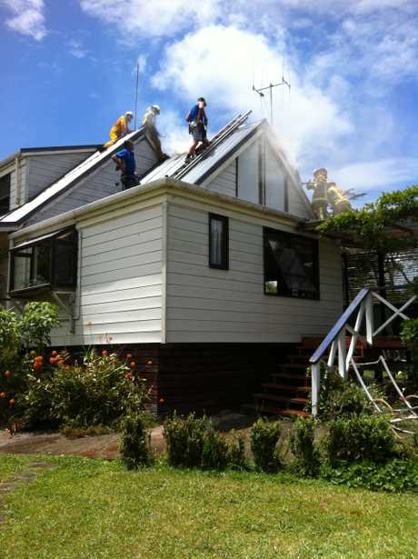 JOINT EFFORT: Firefighters and plumbers joined forces to save a Ngataki house from fire.
