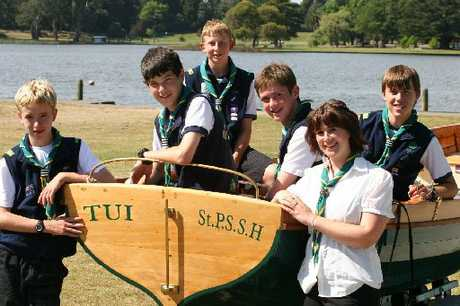 St Peter's Sea Scouts celebrate top honours and their restored kauri cutter. From left _ James McElligott, Matthew Couper, Anthony McAdam, Hamish Dick, Georgina Gibb and Bradley Scott.