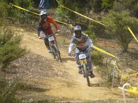 DOWNHILL: Downhill mountainbikers Matt Walker (left) and Louis Hamilton on the charge at the New Zealand Downhill Series held on Saturday.