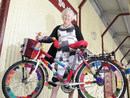 "ARTISTIC SPIN: Margaret Pringle with her portable artwork. She also hopes to ""knit-bomb"" trees outside the Cargo Shed."
