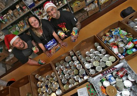 Little Big Market organisers Chris and Rachelle Duffy with musician Tiki Taane at the Tauranga Community Foodbank.