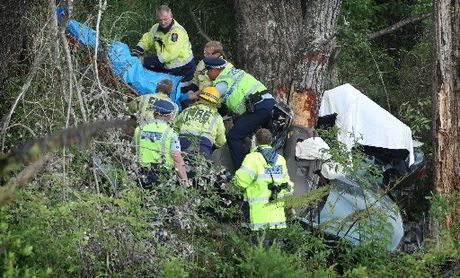 Emergency services remove the bodies of five people from wreckage of a car on Whakamaru Rd.