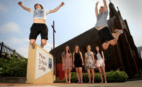 Martin Rose and Callum Inksetter jump for joy as Maddison Sherrah, Mairead Geray, Gaia Herrmann and Mikayla Mongan watch on. Photo: Blainey Woodham / Daily News