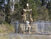 TENSIONS are rising at a coal seam gas exploration site in the NSW North West where a farmer who strapped himself to a drill rig, is refusing to budge.