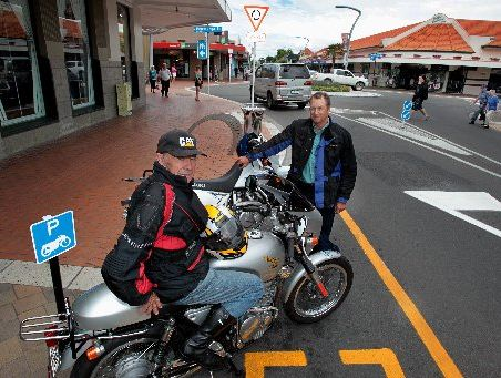 PARKED UP: Hawke's Bay Classic Motorcycle Club member Eric Murfitt (left) and Hastings District councillor Rod Heaps with their motorbikes at one of the new motorcycle parks on Market St, Hastings.