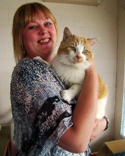 LOVABLE: North Otago's SPCA shelter manager Maree Corder with Orson the cat, who is up for adoption. PHOTO/JESSIE WAITE