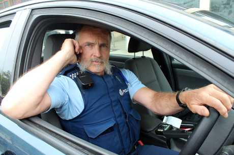 STOPPED: Oamaru police Community Constable Bruce Dow shows that you need to pull over to answer the phone. PHOTO/REBECCA RYAN