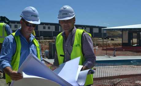 Wade Jackwitz and Craig Kimmorley check out the plans for Diamantina Park, the FKG workcamp at Roma-Surat Rd junction.