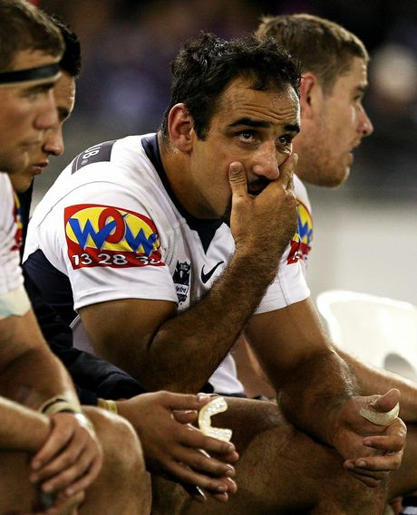 Former Broncos player Tonie Carroll looks on from the bench during the NRL Preliminary Final match between the Melbourne Storm and the Brisbane Broncos at Etihad Stadium on September 26, 2009.